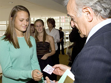 Professor Elie Wiesel accepts peace cards created by area students.